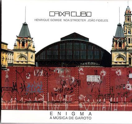 CAIXA CUBO (HENRIQUE GOMIDE, NOA STROETER, JOÃO FIDELES) / ENIGMA - A MÚSICA DE GAROTO