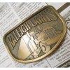 ベルトバックル ヴィンテージ・真鍮製・アメリカ・ベルトバックル・Raleigh Lights【B】