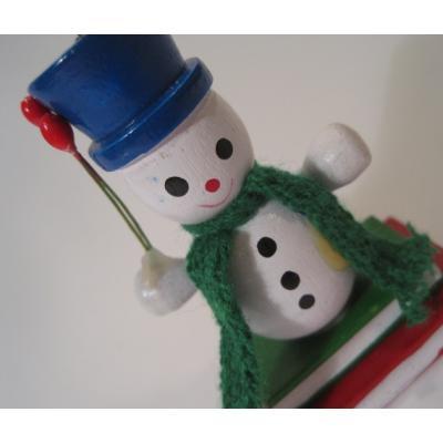 ビンテージクリスマスオーナメント「本の上のスノーマン・ブルーの帽子」